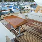 Large aft deck with table and storage set boxes