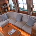 Saloon - Portside 'L' settee with coffee table looking aft