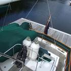 Aft cabin trunk with fender and dingy storage