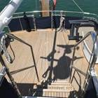 Aft deck showing safe wide teak stair treads from flybridge