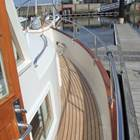Teak decking throughiout deck area with hi-gloss teak bulwark capping and s/s side rails